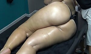 Sexy Mature Wife with Big Booty Stuck on Massage Bed together with xxx  her Masseur Labelling her Pussy as her Husband was waiting outside !