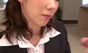 Hitomi Oki looks agog to palce this gumshoe up her hairy pussy